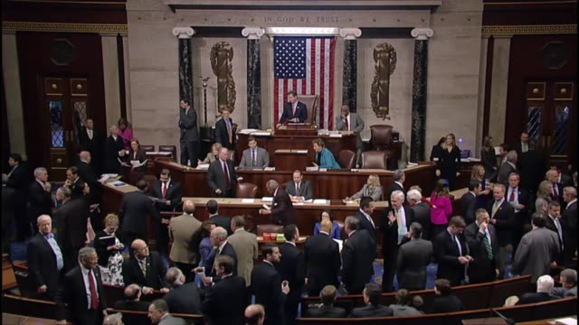 Members of the House of Representatives socializing as a vote draws to a close