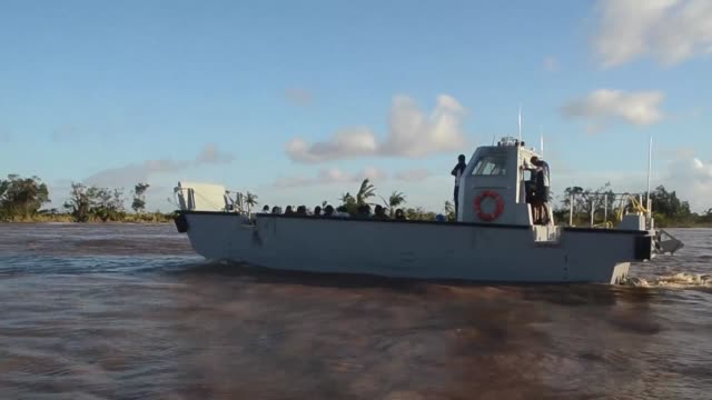stockvideo's en b-roll-footage met members of the indian navy together with aid workers set up a triage and medical centre at the port in beira to help people who have been displaced... - triage