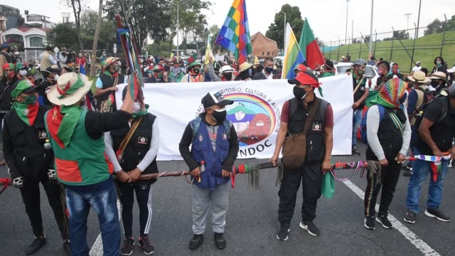 members of the indigenous guard get ready to march with thousands of indigenous colombians against the government on october 19, 2020 in bogota,... - indigenous peoples of the americas stock videos & royalty-free footage