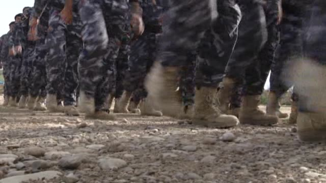 members of the iraqi army and volunteer fighters receive military training at a camp in bashiqa region of mosul before an operation to recapture... - ninawa stock videos & royalty-free footage