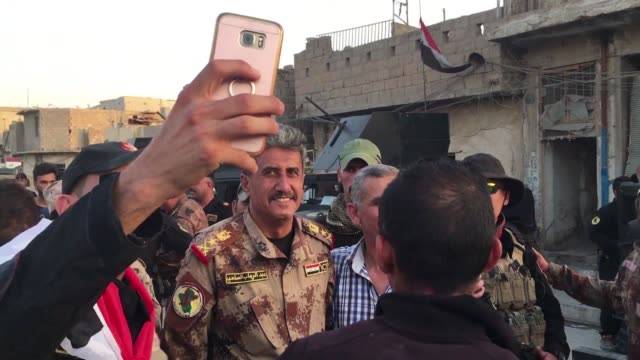members of the iraqi security forces celebrated on monday in mosul after iraqi prime minister haider alabadi announced his forces had ended the... - iraqi prime minister stock videos & royalty-free footage