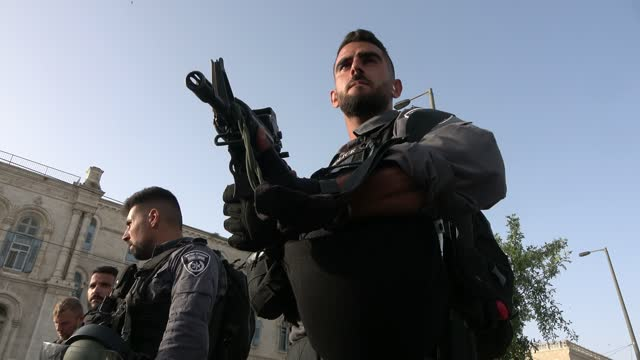 """members of the israeli security forces stand guard as they block the way to damascus gate during the annual jewish nationalist """"jerusalem day"""" march... - israel stock videos & royalty-free footage"""