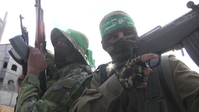 members of the izz eldeen alqassam brigades the military wing of hamas movement stage a demonstration to protest us president donald trump's... - hamas stock videos & royalty-free footage