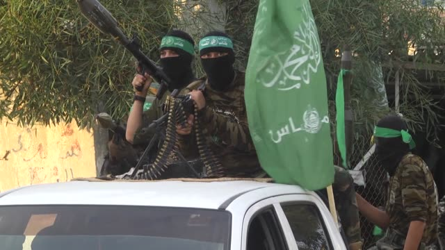 members of the izz eldeen alqassam brigades the military wing of hamas movement take part in a military parade to mark the 30th anniversary of hamas'... - hamas stock videos & royalty-free footage