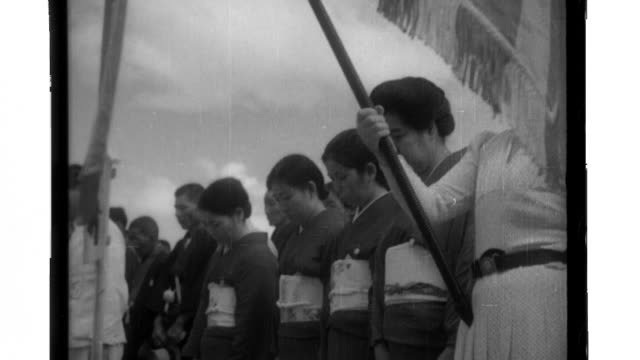 members of the japanese community on palau watch as the palanquin for the nanyo shrine arrives on the saipan maru then is transported to the shrine... - shinto stock videos & royalty-free footage
