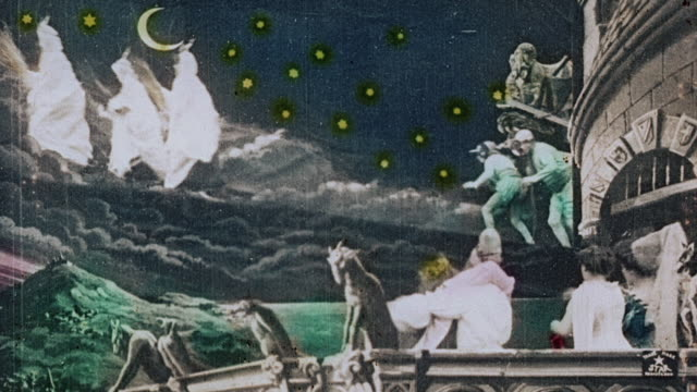 vídeos de stock e filmes b-roll de 1903 ws members of the king's court watching in horror as the queen is abducted in the film illusions, le royaume des fées (the kingdom of fairies) by georges melies - colorido a mão