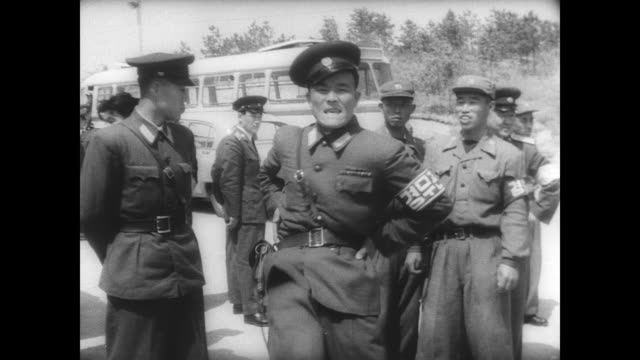 Members of the Korean War Joint Armistice Commission meets to discuss minor peacekeeping issues in Panmunjom Korea / outside after meeting a Korean...
