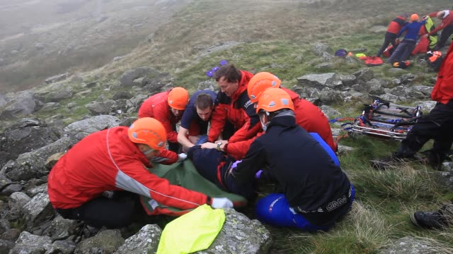 members of the langdale ambleside mountain rescue team on a first aid training exercise in the lake district uk - helmet stock videos & royalty-free footage