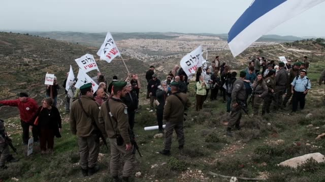 Members of the leftwing Peace Now movement taking part in a protest next to the illegal outpost of Nativ Ha'avot in the Gush Etzion cluster of Jewish...