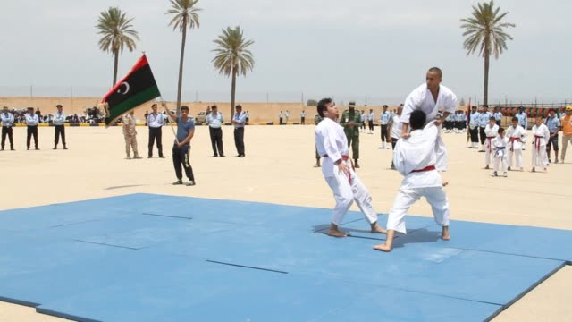 Members of the Libyan customs guard took part in a graduation ceremony in Tripoli on Monday showing off their skills and expertise