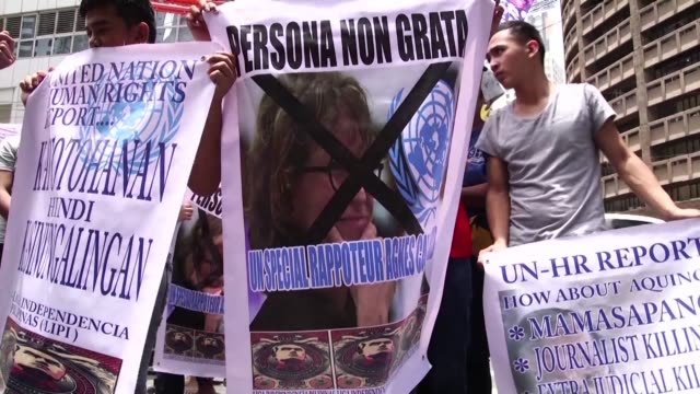 Members of the Liga Independencia Filipina protest outside the United Nations office