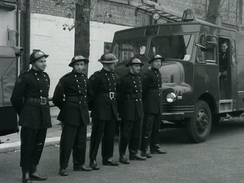 Members of the London Auxiliary Fire Service prepare to take part in a convoy around the streets of London
