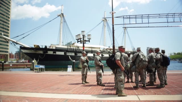 members of the maryland national guard are seen at the inner harbor baltimore maryland may 2 2015 freddie gray was arrested for possessing a switch... - hafen von baltimore stock-videos und b-roll-filmmaterial