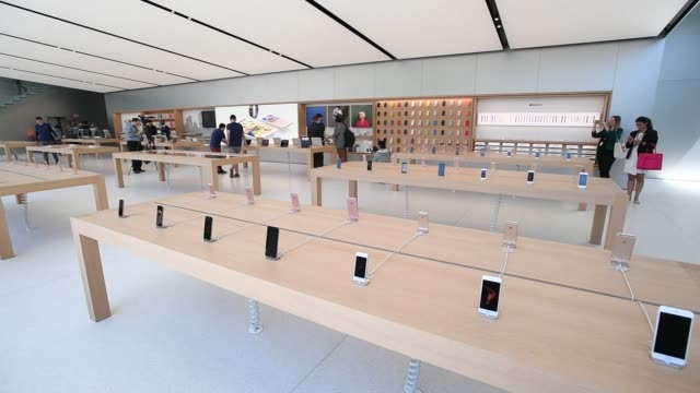 Members of the media and attendees browse the new Apple Inc flagship store at Union Square in San Francisco California US on Thursday May 19 2016...