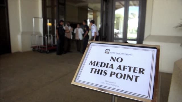 members of the media are barred from a hotel near putrajaya where relatives of chinese passengers onboard the missing mh370 are staying - putrajaya stock videos & royalty-free footage