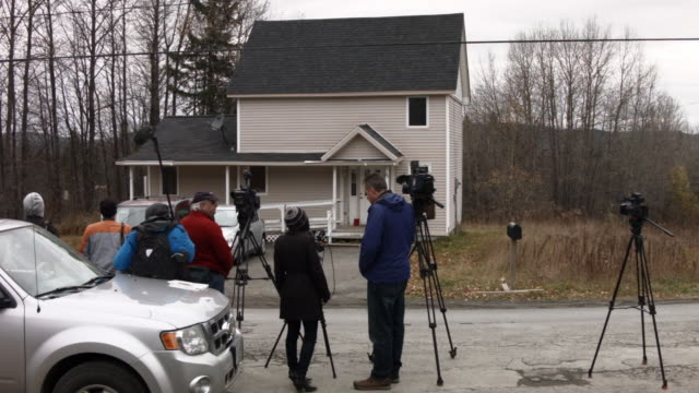 members of the media wait outside the house that kaci hickox shares with a boyfriend october 30 2014 in fort kent maine after returning from sierra... - the morning after stock videos & royalty-free footage