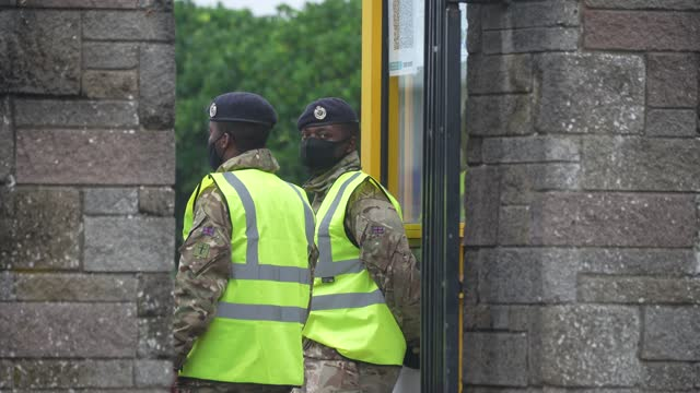 members of the military arrive at pontins by ainsdale beach to set up a mass covid19 testing facility on november 5 2020 in southport england the uk... - southport england stock-videos und b-roll-filmmaterial