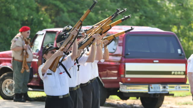 members of the monroe county honor guard fire three volleys in a 21 gun salute to honor fallen members of the military during memorial day ceremonies... - veterans of foreign wars of the united states stock videos & royalty-free footage