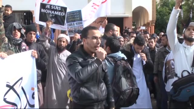 members of the moroccan salafist movement shout slogans as they hold placards during a protest on january 23, 2015 in the coastal town of sale... - satire stock-videos und b-roll-filmmaterial