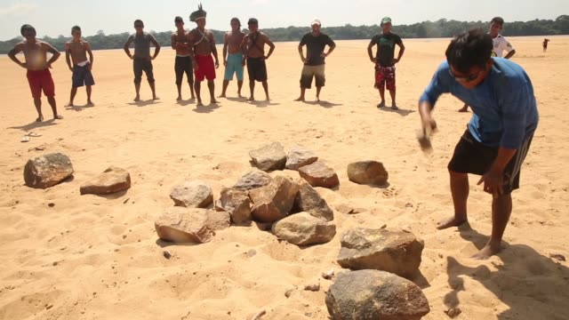 members of the munduruku indigenous tribe break rocks along the tapajos river during a 'caravan of resistance'' protest by indigenous groups and... - para state stock videos & royalty-free footage