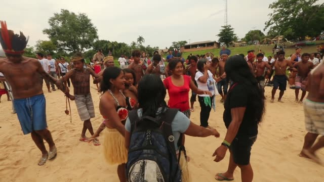 members of the munduruku indigenous tribe dance along the tapajos river during a 'caravan of resistance'' protest by indigenous groups and supporters... - para state stock videos & royalty-free footage