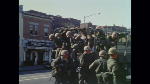 members of the national guard drive down city streets and throw smoke bombs to disperse crowd after washington riots - national guard stock videos and b-roll footage