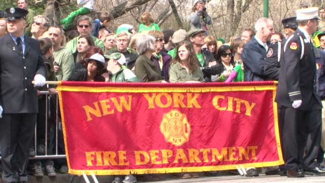 members of the new york city fire department march in the 2012 st patrick's day parade / westchester firefighters pipes and drum corp march in the... - fire department of the city of new york stock-videos und b-roll-filmmaterial