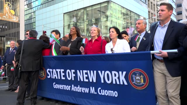 members of the new york state democratic party hold banners during the annual columbus day parade on october 10 2016 on 5th avenue manhattan new york... - andrew cuomo stock videos and b-roll footage