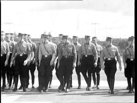 Members of the NSKK unit M29 in uniform practicing marching formations near Olympic stadium Berlin