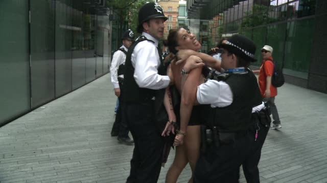 Members of the nude feminist protest group Femen staged a demonstration outside London's City Hall on Thursday against the presence in the Olympics...