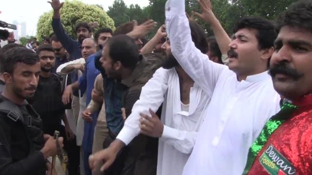 Members of the Pakistani opposition react to Prime Minister Nawaz Sharif's disqualification by the Supreme Court over long running corruption...