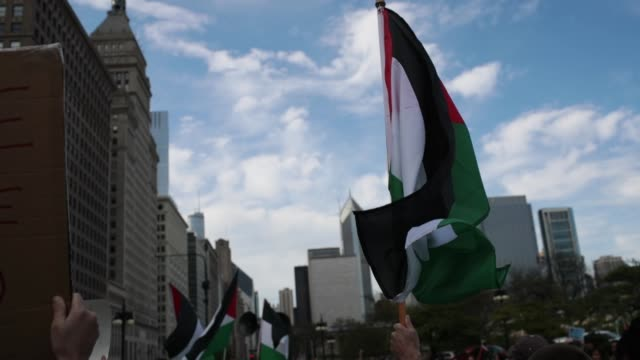 Members of the Palestinian community and their supporters rally and march toward the Israeli consulate to protest President Donald Trump's decision...