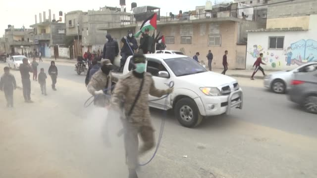 members of the palestinian islamic jihad's armed wing, the al-quds brigades, spray disinfectant in the streets of rafah in the southern gaza strip,... - gaza strip stock videos & royalty-free footage