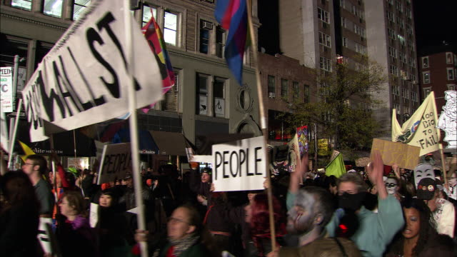 members of the protest group occupy wall st. hold signs and walk in costume in the parade - occupy protests stock videos & royalty-free footage