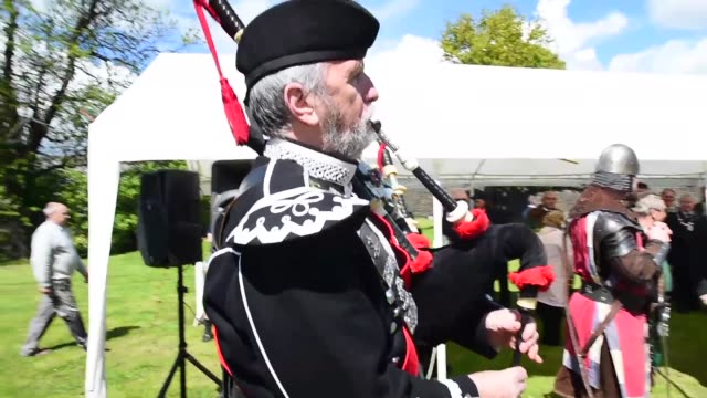 members of the public attend a ceremony at the stirling bridge battle site as the saltire was raised for the first time in 700 years on may 29, 2015... - bagpipes stock videos & royalty-free footage
