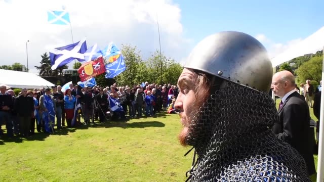 members of the public attend a ceremony at the stirling bridge battle site as the saltire was raised for the first time in 700 years on may 29 2015... - stirling stock videos and b-roll footage