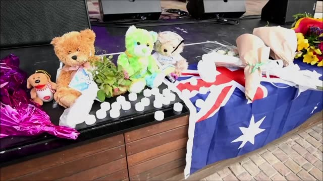 Members of the public attend a vigil at Federation Square in Melbourne in memory of the five people mown down by a car at Melbourne's busiest mall on...