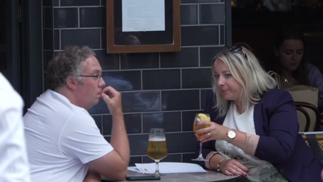 members of the public enjoy food and drink on july 04, 2020 in london, england. the uk government announced that pubs, hotels and restaurants can... - food stock videos & royalty-free footage