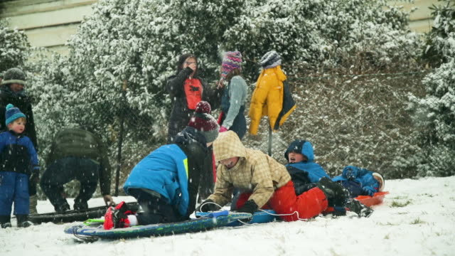 members of the public enjoy sledding on the west front of the u.s. capitol february 20, 2019 in washington, dc. a winter storm has brought a few... - sledge stock videos & royalty-free footage
