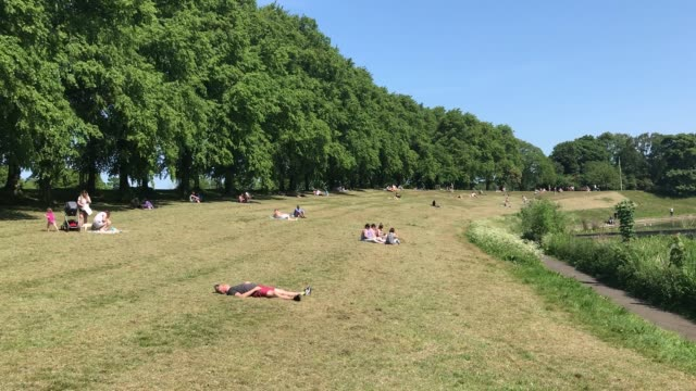 members of the public enjoy the sunshine at a park in edinburgh following the relaxation of lockdown measures in scotland. from friday scottish... - sunlight stock videos & royalty-free footage