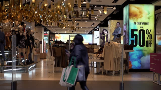 members of the public enter the top shop store on oxford street on the first morning of the new covid regulation three tier system is implemented... - turning on or off stock videos & royalty-free footage