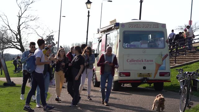 members of the public flock the park to enjoy the sun and an ice cream van during lockdown on february 22, 2021 in london, england at alexandra... - springtime stock videos & royalty-free footage