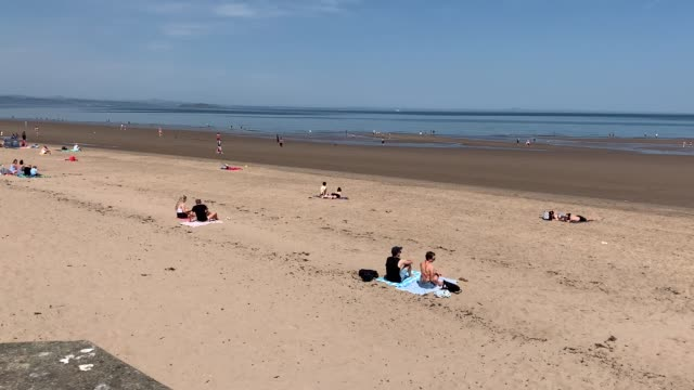 members of the public keep their distance as they sunbathe at portobello beach in edinburgh. - portobello mushroom stock videos & royalty-free footage