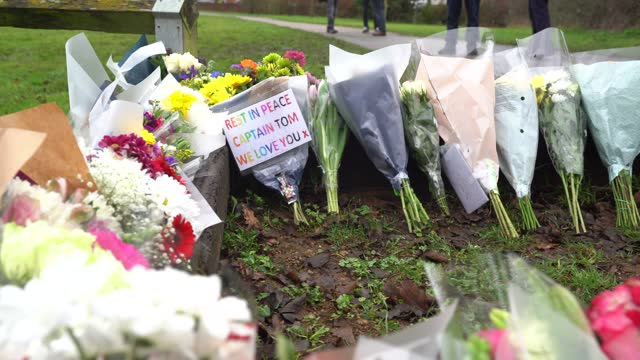 members of the public leave floral tributes seen near the former home of captain sir tom moore following the announcement of his death the previous... - weather stock videos & royalty-free footage
