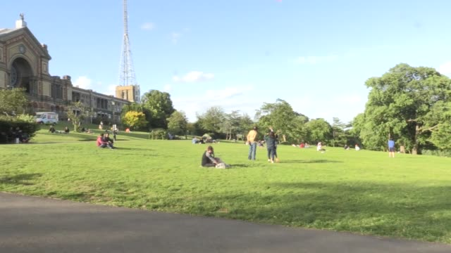 members of the public make the most of the bank holiday sunshine on saturday in alexandra palace park in north london. government advice now allows... - sunlight stock videos & royalty-free footage