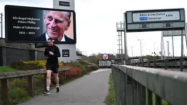 members of the public make their way past a digital display showing an image of prince philip, duke of edinburgh, who passed away yesterday aged 99,... - digital display stock videos & royalty-free footage