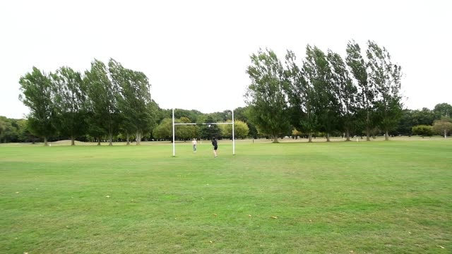 members of the public play on an otherwise empty rugby field at hagley park on march 21, 2020 in christchurch, new zealand. sporting codes across new... - all around competition stock videos & royalty-free footage
