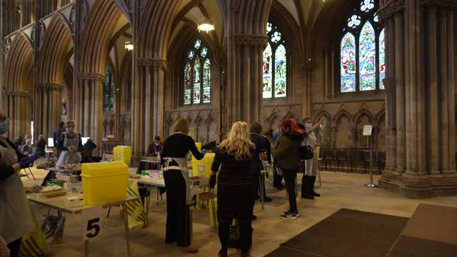 members of the public receive their covid-19 vaccinations at lichfield cathedral, staffordshire on february 26, 2021 in lichfield, england. lichfield... - スタッフォードシャー リッチフィールド点の映像素材/bロール