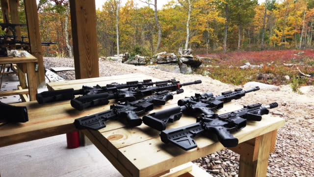 """members of the public shoot ar15 rifles and other weapons at a shooting range during the """"rod of iron freedom festival"""" on october 12 2019 in greeley... - rod stock videos & royalty-free footage"""