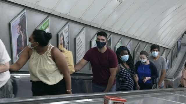 members of the public still wearing faces masks as they use the escalators on london underground freedom day 2021 as the uk moves out of lockdown... - coronavirus stock videos & royalty-free footage